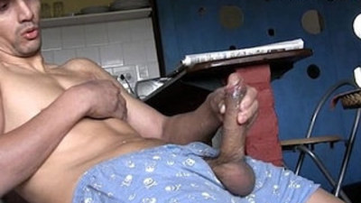 Masculine Latino top with a huge and beautiful uncut cock strokes his meat.