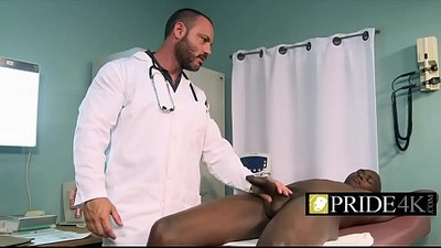 Gay doctor checking penis firmness with cum in mouth