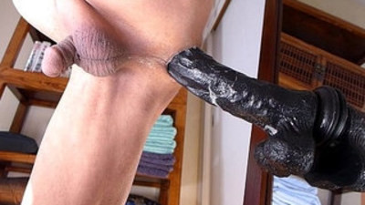 Man masturbating anal with black dildo and lot of cums.